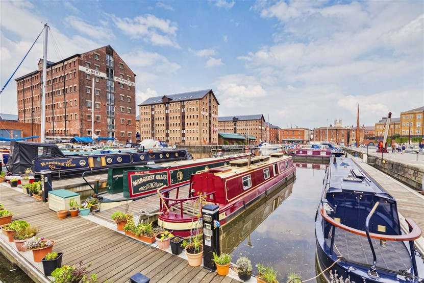 "<img src=""gloucester-docks-victoria-basin-©-shutterstock.jpeg"" alt=""Gloucester Docks""/>"