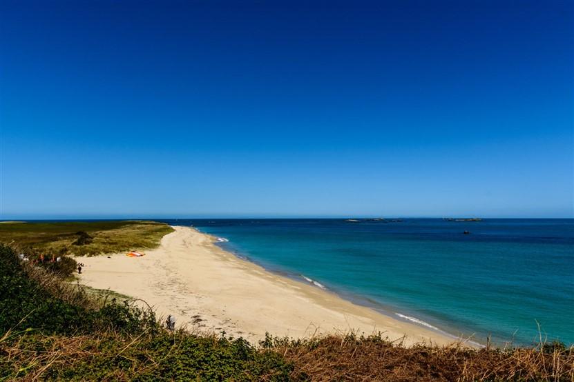 """<img src=""""shell-beach-herm-shutterstock.jpeg"""" alt=""""Shell Beach Herm""""/>"""