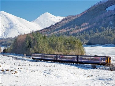 "img src=""020310156passinglochannabi01mtdcopy.jpeg"" alt=""Train passing Loch Annan"">"
