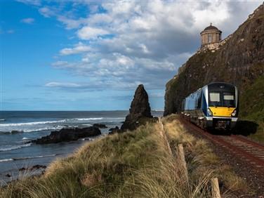 """<img src=""""castlerock-with-translink-train-©-shutterstock.jpeg"""" alt=""""Castlerock & Downhill Tunnels""""/>"""