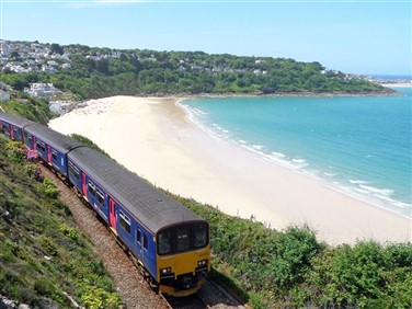 "<img src=""fgw-train-on-the-st-ives-bay-line-by©mark-lynam.jpeg"" alt=""St Ives Bay""/>"