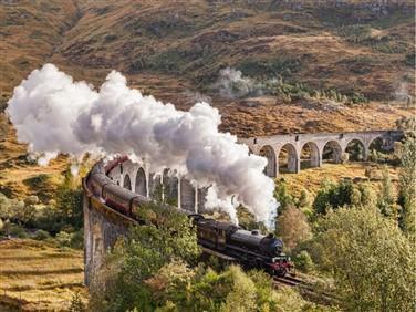 """<img src=""""glenfinnanviaductjacobiteautumn-shutterstock.jpeg"""" alt=""""Jacobite Steam Train""""/>"""
