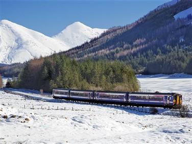 "img src=""passinglochanna©normanmcnab.jpeg"" alt=""Train passing Loch Annan""/>"