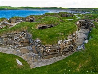 "<img src=""skarabrae_orkney©shutterstock.jpeg"" alt=""Skara Brae""/>"