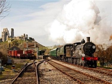 "<img src=""swanage-railway-&-corfe-castle-©-swanagerailway.jpeg"" alt=""Swanage Railway""/>"
