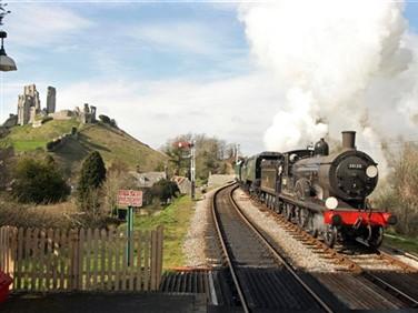 "<img src=""swanagerailwaycorfecastlebackground.jpeg"" alt=""Swanage Railway""/>"