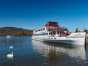 "<img src=""theswanatbownesspier©gaidkornsilapa-shutterstock.jpeg"" alt=The Swan Lake Windermere""/>"