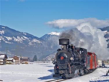 """<img src=""""winterimage-copyrightchrislewisoktouse.jpeg"""" alt=""""Steam Train in the Tyrol""""/>"""