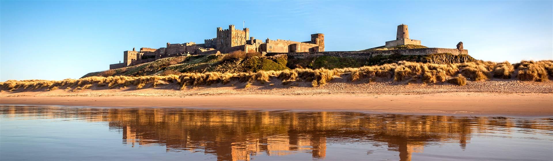 """<img src=""""bamburgh_castle2©shutterstock.jpeg"""" alt=""""Bamburgh Castle""""/>"""