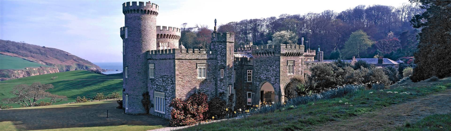 "<img src=""caerhays_castle©shutterstock.jpeg"" alt=""Caerhays Castle""/>"