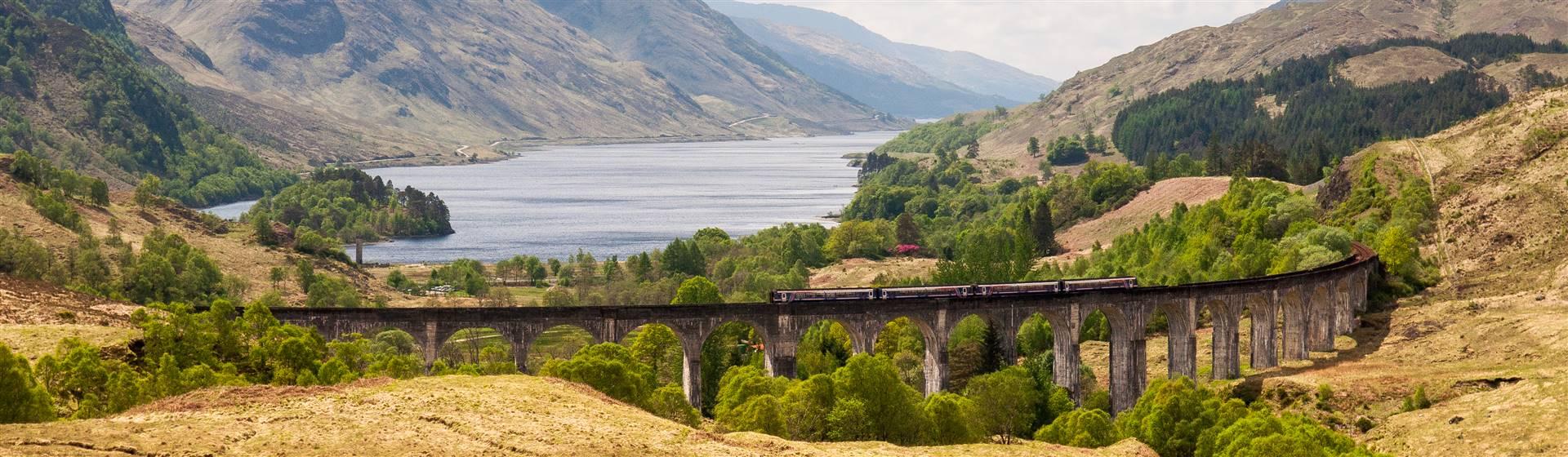 """<img src=scotrailpassengertraincrossestheglenfinnanviaductshutterstock_l"""" alt=""""Glenfinnan Viaduct""""/>"""