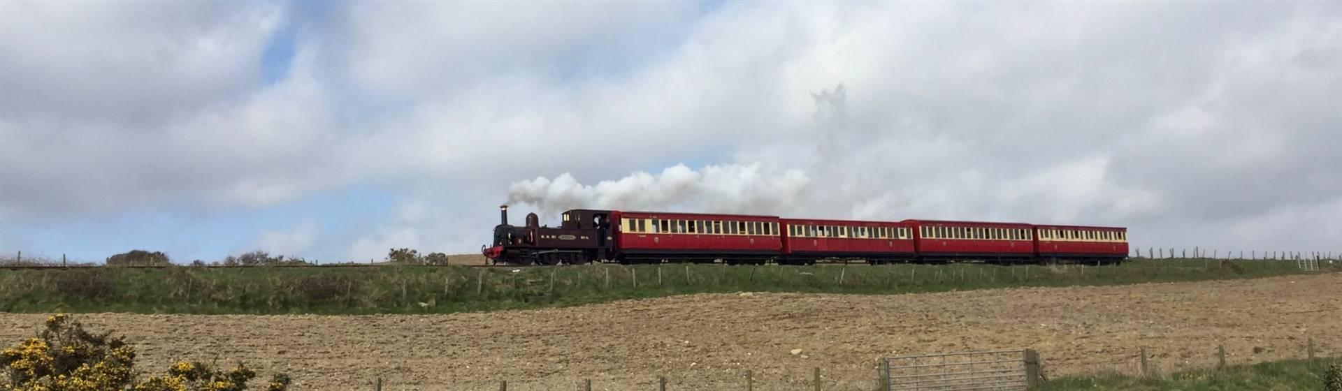 "<img src=""heritageandexplorertours.jpeg"" alt=""Isle of Man Steam Explorer""/>"