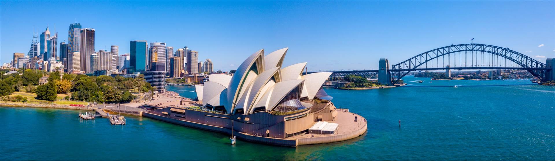 "<img src=""sydney-shutterstock_741014362.jpeg"" alt=Sydney Harbour""/>"