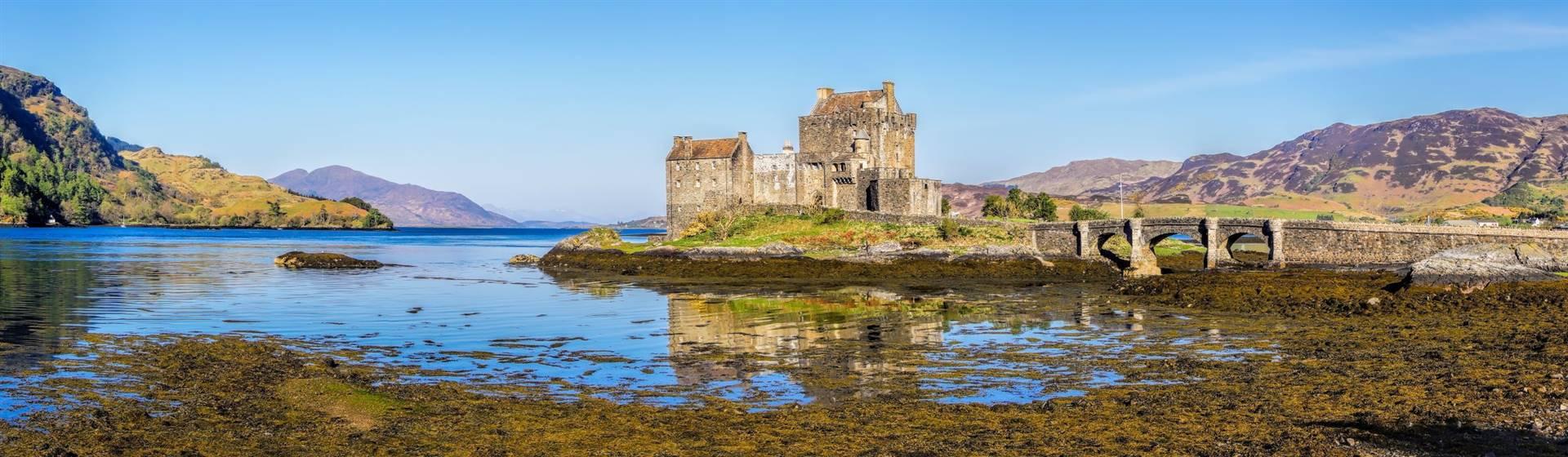 "<img src=""eileandonancastle-shutterstock.jpeg"" alt=""Eilean Donan Castle - Scotland""/>"