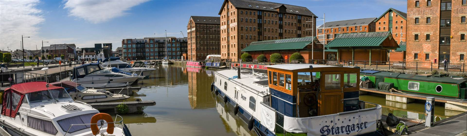 "<img src=""gloucesterdocks-shutterstock.jpeg"" alt=""Gloucester Docks""/>"