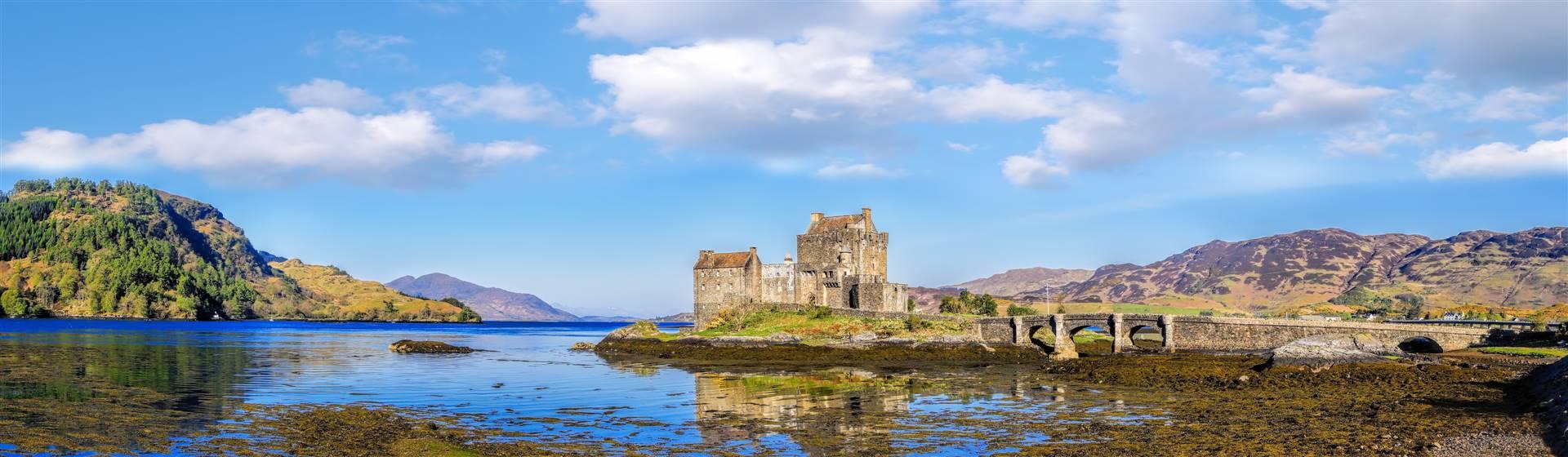 "<img src=""gtbruk-shutterstock.jpeg"" alt=""Eilean Donan Castle in Highlands of Scotland""/>"