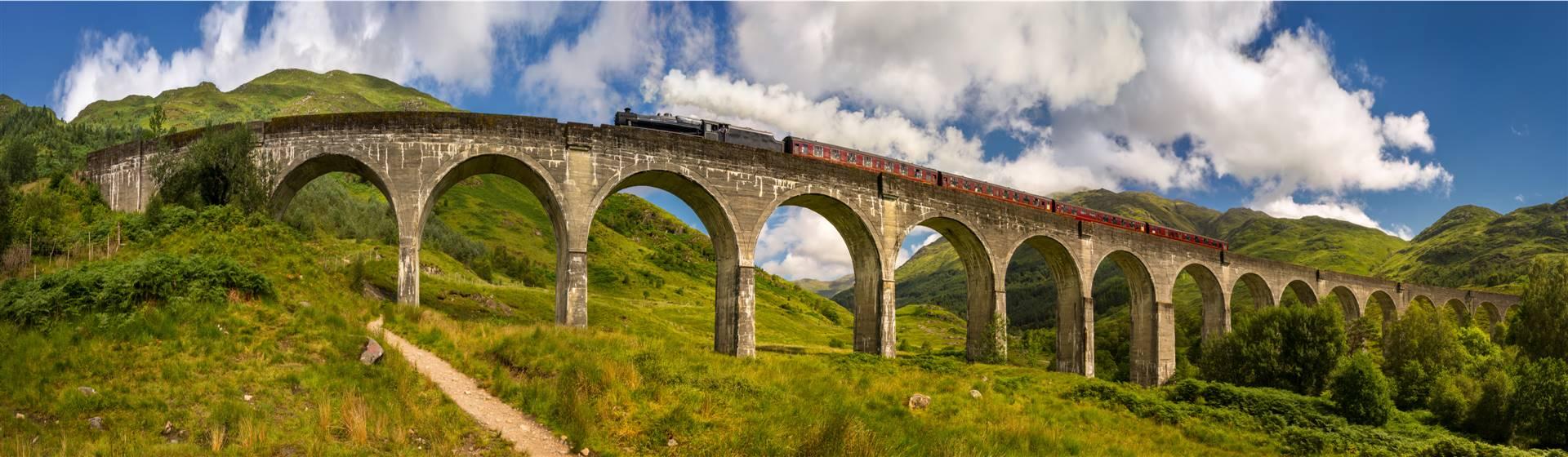 "<img src=""jacobiteonglenfinnanviaductshutterstock.jpeg"" alt=""Jacobite on the Glenfinnan Viaduct""/>"
