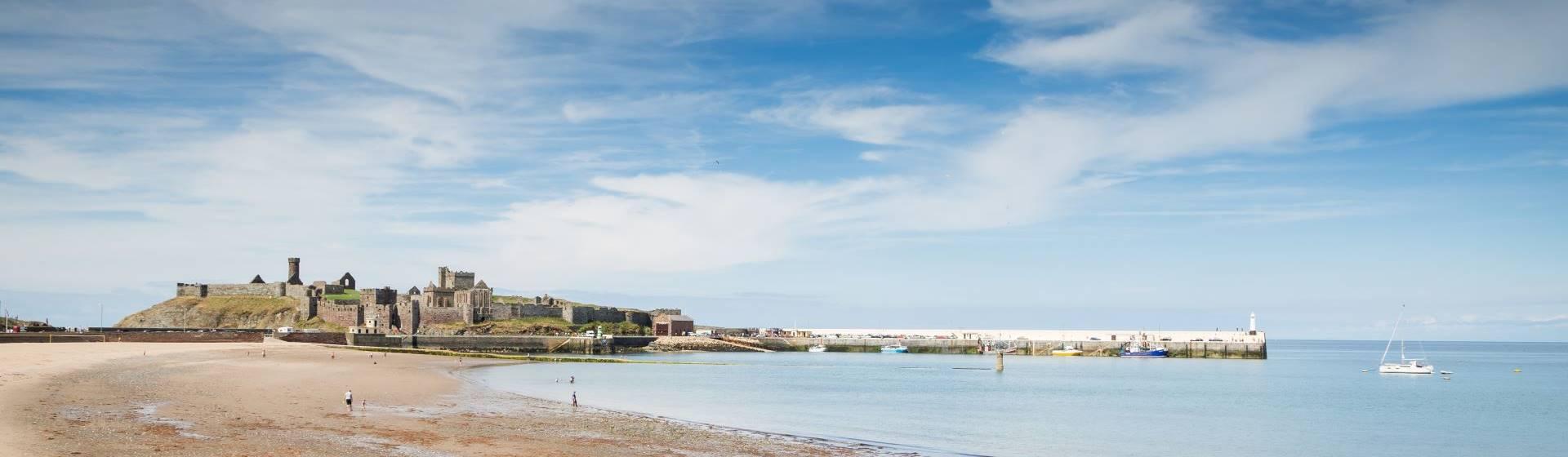 """<img src=""""peelcastleisleofman-adobestocklr.jpeg"""" alt=""""Peel Castle Isle of Man""""/>"""