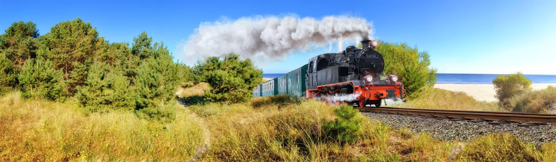 """<img src=""""rugensteampan-shutterstock.jpeg"""" alt=""""Rugen Steam Train""""/>"""