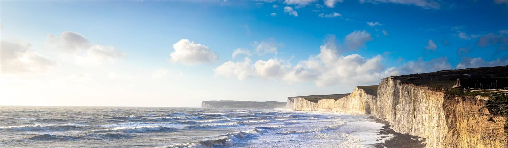 """<img src=""""sevensisterschalkcliffs-shutterstock.jpeg"""" alt=""""Seven Sisters Cliffs Sussex""""/>"""