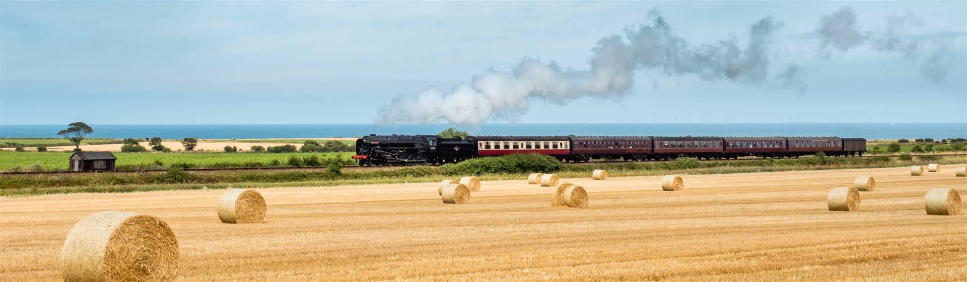 """<img src=""""steamtrainonthepoppyline-shutterstock.jpeg"""" alt=""""Steam train on the Poppy line""""/>"""