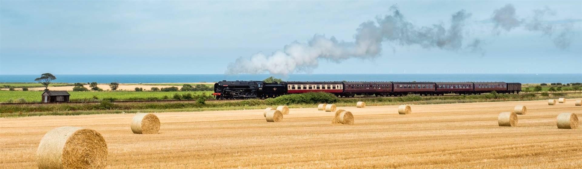 """<img src=""""teamtrainonthepoppyline-shutterstocklr.jpeg"""" alt=""""Steam train on the Poppy line""""/>"""