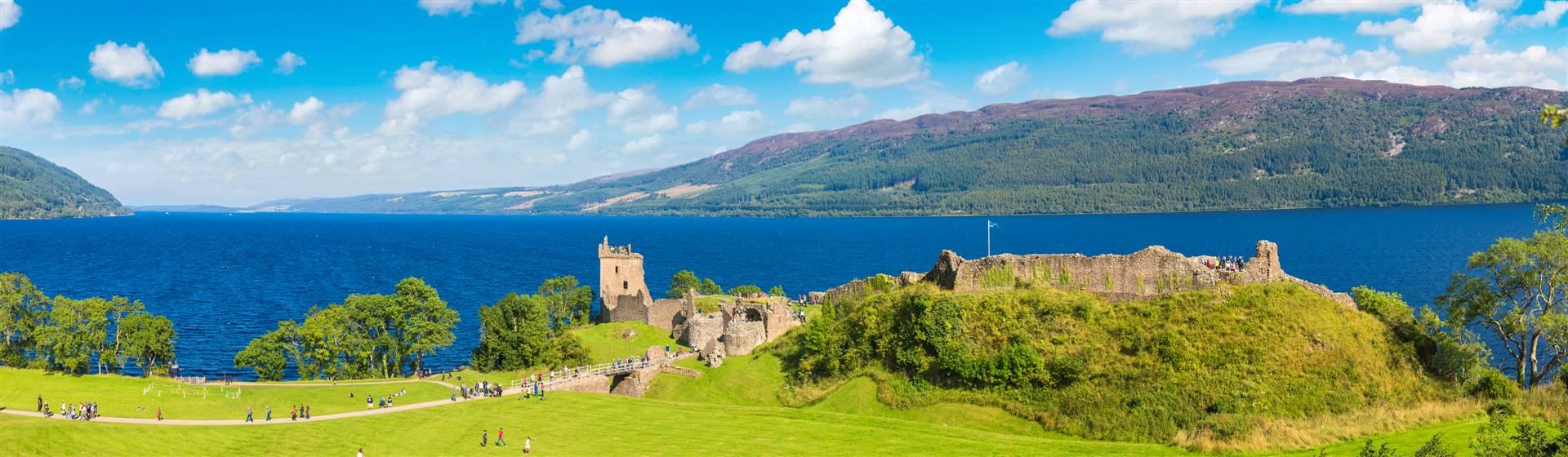 "<img src=""urquartcastleandlochness-shutterstock.jpeg"" alt=""Urquart Castle and Loch Ness""/>"
