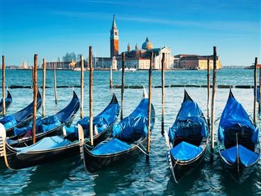 "<img src=""bluegondolasvenice-shutterstock.jpeg"" alt=""Blue Gondolas Venice""/>"