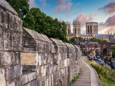 "<img src=""cityofyork.medievalwalls©shutterstock.jpeg"" alt=""York/"">"