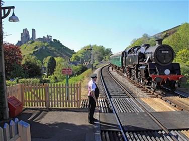 "<img src=""swanage-loco-pulling-into-corfe-castle-station-©swa"" alt=""Swanage Loco at Corfe Station""/>"